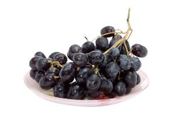 Bunch of grapes on the plate Stock Photography
