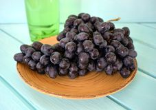 Bunch of grapes. A bunch of grapes on a plate Stock Images