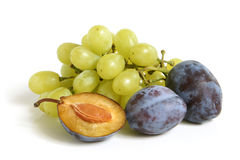 Bunch of grapes and plums Royalty Free Stock Photo