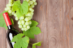 Bunch of grapes and red wine bottle Royalty Free Stock Images