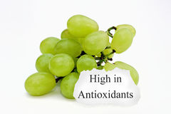 Bunch of grapes. A bunch of grapes with a sign saying High in Antioxidants Royalty Free Stock Image