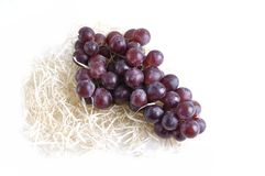 Bunch of  grapes on straw and isolated Royalty Free Stock Photos