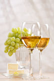 Bunch of grapes and white wine Stock Photos