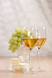 Bunch of grapes and white wine Stock Images