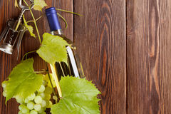 Bunch of grapes, white wine bottle and corkscrew Royalty Free Stock Image