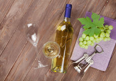Bunch of grapes, white wine and corkscew. Bunch of grapes, white wine and corkscrew on wooden table background stock photos