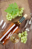 Bunch of grapes, white wine and corkscew. Bunch of grapes, white wine and corkscrew on wooden table background stock photography
