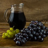 Bunch of grapes and Wine jug Royalty Free Stock Photo