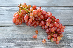 Bunch of grapes on a wooden board Royalty Free Stock Images