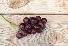 Bunch of grapes. On a wooden table Stock Images