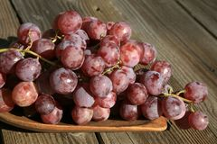Bunch of grapes on a wooden table royalty free stock photos