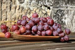 Bunch of grapes on a wooden table stock photography