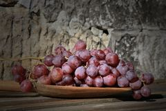 Bunch of grapes on a wooden table royalty free stock photography