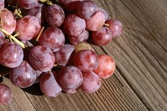 Bunch of grapes on a wooden table an old, country house. royalty free stock images