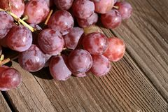 Bunch of grapes on a wooden table an old, country house. stock photography