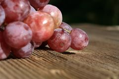 Bunch of grapes on a wooden table royalty free stock images