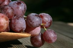 Bunch of grapes on a wooden table royalty free stock image