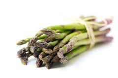 Bunch of green asparagus isolated on a white background, closeup Royalty Free Stock Image