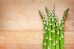 Bunch of green asparagus on wooden desk Stock Image