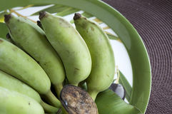 Bunch of green banana on tray Royalty Free Stock Photos