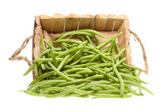 Bunch of green beans coming out of a wooden basket Royalty Free Stock Photo