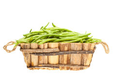 Bunch of green beans in a wooden basket Stock Photography