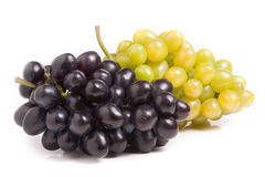 Bunch of green and blue grape isolated on white background Royalty Free Stock Photos