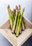 Bunch of green fresh asparagus. In a wooden box Royalty Free Stock Image