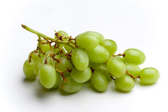 Bunch of green grapes. A bunch of green grapes on a white background Stock Photos