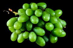 Bunch of green grapes. On a black background royalty free stock photos