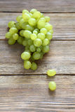 Bunch green grapes on boards Royalty Free Stock Photos