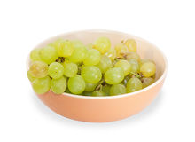 Bunch of green grapes in a brown bowl isolated Stock Photo
