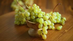 Bunch of green grapes on a dark wooden table stock video