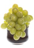 Bunch of green grapes in glass bowl Stock Images