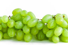 Bunch of green grapes on white Stock Images