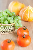 Bunch green grapes wicker Royalty Free Stock Image