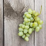 Bunch of green grapes on wooden background Stock Photography