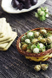 Bunch of green hazelnuts with biscuits and truffles. On background Royalty Free Stock Image