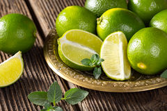 Bunch of green limes. Stock Image