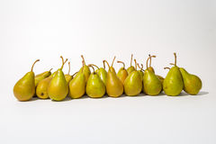 A bunch of green pears in a row. A bunch of fresh green pears in a row on a white background stock photography