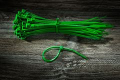 Bunch of green plastic cables on vintage wooden board royalty free stock image