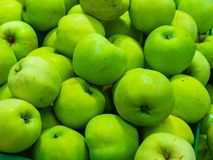 Bunch of green and red apples on boxes in supermarket royalty free stock image