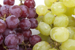 Bunch of green and red grapes on  white  Royalty Free Stock Photo
