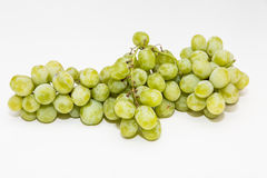 Bunch of Green Seedless Grapes on a White Background Royalty Free Stock Photos