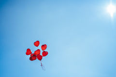 Bunch of group red balloons on a blue sky Royalty Free Stock Photography