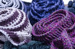 A bunch of  handmade colorful woolen scarfs Royalty Free Stock Image