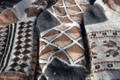 Bunch of handmade colorful woolen socks. Bunch of handmade colorful ethnic styled woolen socks on the traditional fair royalty free stock images