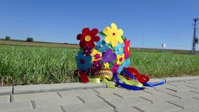 A bunch of handmade flowers in a folk basket with blue and yellow colors stock footage