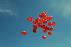 Bunch of heart shaped balloons flying in the sky Royalty Free Stock Photo