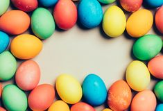 Bunch of home-dyed eggs. Copyspace. Bunch of home-dyed eggs creating round copyspace in the centre. Easter Stock Image